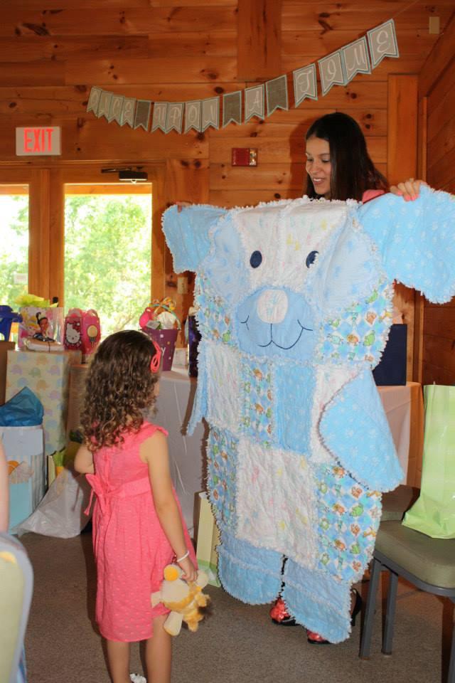 She loved the bear blanket for her little brother!
