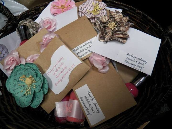 Favors: We had flower seeds in little envelopes for guests to take with them and plant. We also had pink nail polish for the younger guests:)