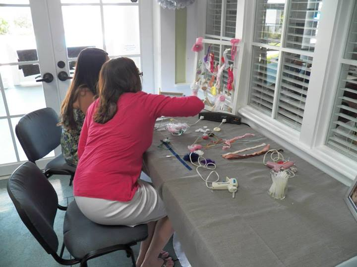 Create a Headband for Baby Ebner Station. Guests were able to make a headband for the baby with the materials provided.